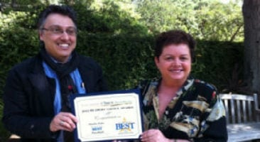 Two faculty receiving reward for best preschool