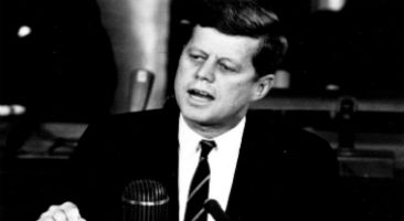 John F Kennedy speaking at a podium