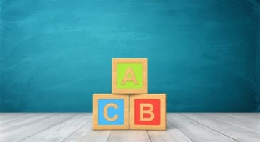 Three blocks with A, B, and C letters in a pyramid formation